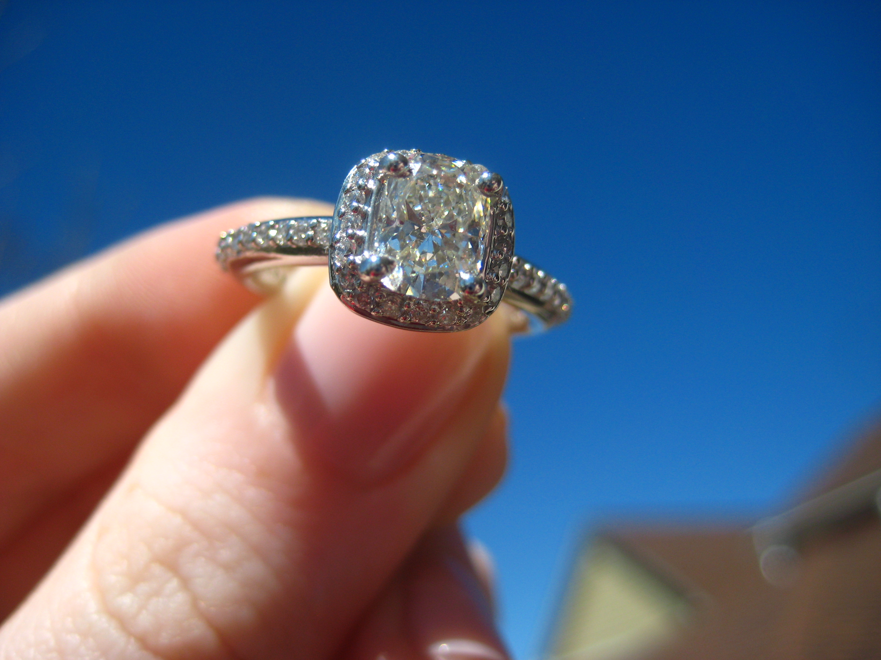 Vintage Cushion Cut Diamond In A Halo Pave Setting It